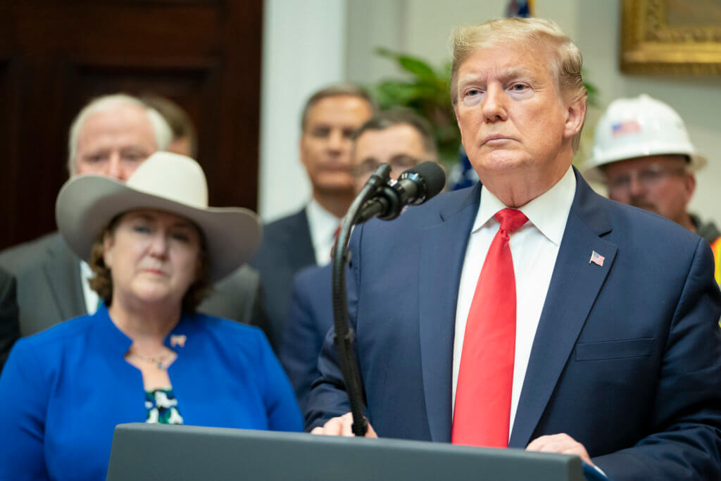 President Donald J. Trump listens to a reporter's question after his announcement of the proposed changes to National Environmental Policy Act (NEPA) regulations Thursday, Jan. 9, 2020, in the Roosevelt Room of the White House.